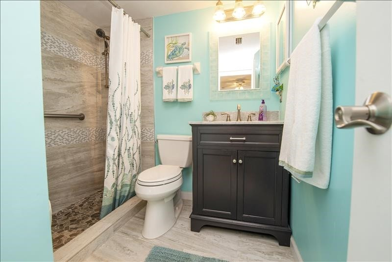 Master Bathroom Upgraded Walk-In Shower with Grab Bars
